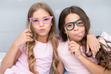 Playful Mood. Girls Children Posing With Grimaces Photo Booth Props. Pajamas Party Concept. Girls Friends Having Fun Pajamas Party. Friends Cute And Cheerful Posing With Eyeglasses Accessories