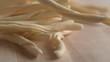 Throwing riccioli pasta on wooden surface. Shot with high speed camera, phantom flex 4K. Slow Motion.