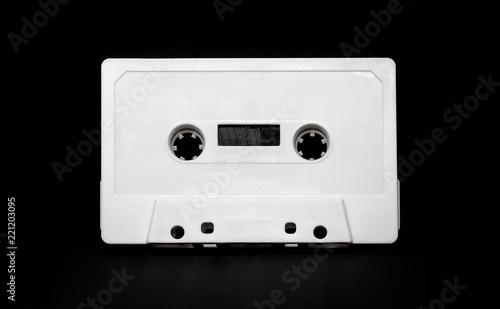Fotografija Bulk audiocassette on black background