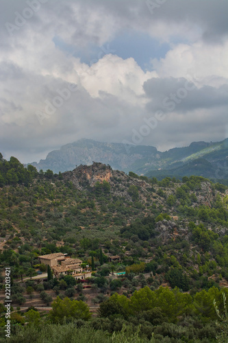 Majestic mountain landscape with sun and shade and green nuances