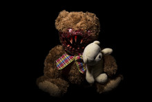 A Terrible Bear On A Black Background With A Cute Bear In His Hands