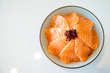 Close Up Salmon Slice. Salmon Topped By Fresh Salmon Served With Wasabi And Soy Sauce, Donburi Rice. Image For Background, Copy Space, Decorate And Menu List.