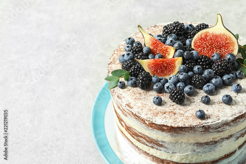 Delicious homemade cake with fresh berries on table, closeup