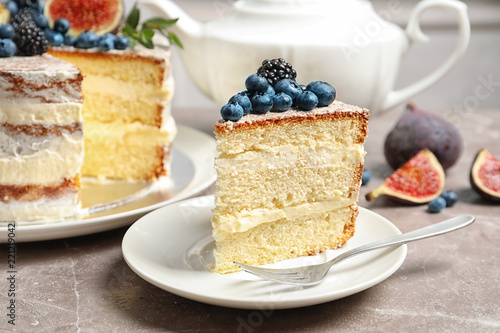 Piece of delicious homemade cake with fresh berries served on table