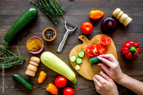 Papiers peints Nature Cut different fresh vegetables on cutting board for cooking vegetable stew. Dark wooden background top view