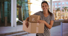 Beautiful Young Woman Standing Outside Office Building Holding Shipping Boxes