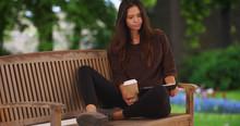 Millennial Woman Sitting On Pa...