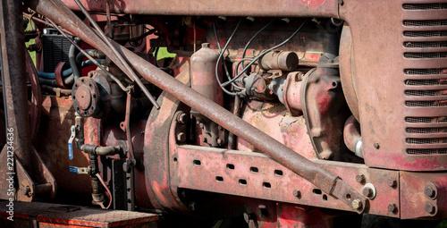 фотография  Antique tractor motor engine