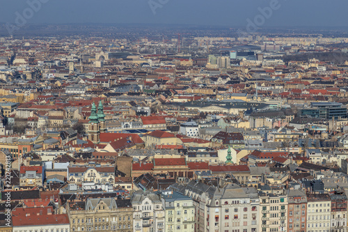 Foto  Budapest Aerial panorama many roofs of historic buildings on the banks of the Don with docks for pleasure craft