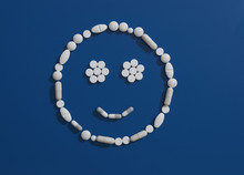 Pills Forming Smiley Face On B...
