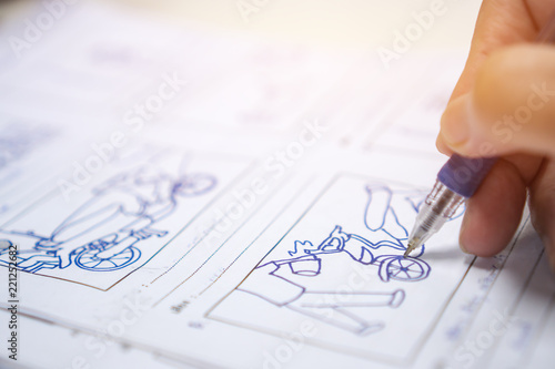 Artis drawing creative Storyboard or storytelling for film process on pre-production media films story script for video editors