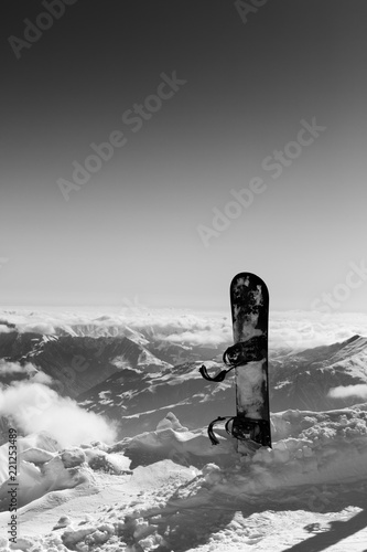 Black and white view on snowboard in snow on off-piste slope