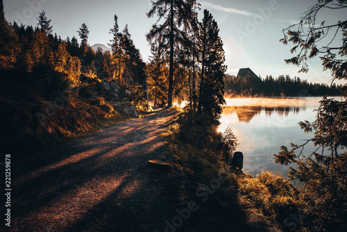 Deurstickers Zwart Beautiful morning scenery by lake