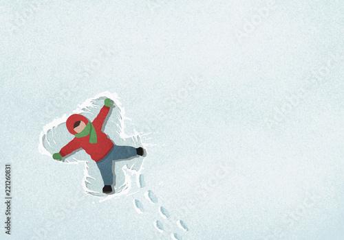Carefree boy making snow angel