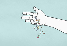 Hand Dropping Pills On Blue Background