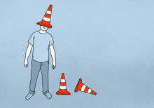 Man With Traffic Cone On Head