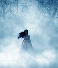 Ghost woman in foggy forest...