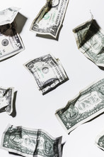 Folded And Crumpled One Dollar Bills On White Background