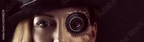 Fotografie, Obraz  Steampunk girl portrait on black. Monocular lens