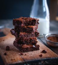 Close-up Of Homemade Chocolate Brownies On Cutting Board