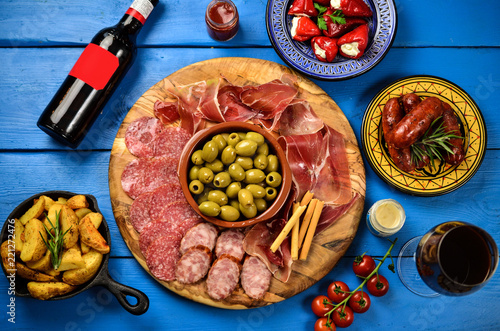 Traditional tapas bar, spanish table with food, platter with appetizers, cold meats and wine snack set, overhead