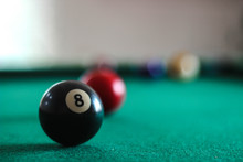Colorful Pool Balls On A Green Billiard Table