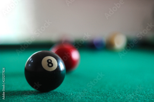 Obraz na plátně Colorful pool balls on a green billiard table