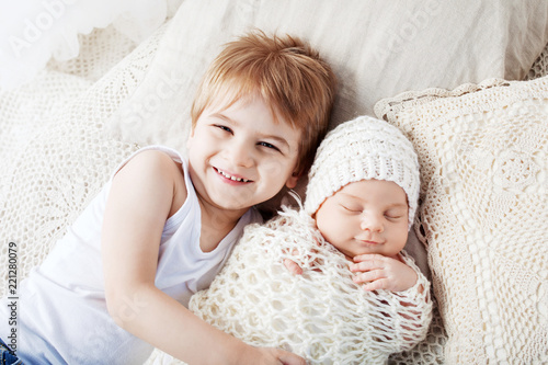 Valokuva  Portrait of newborn baby and elder brother