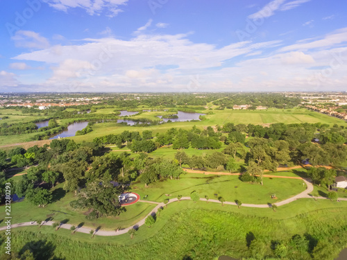 Foto op Aluminium Purper Aerial urban green park with suburban Houston neighborhood in distance. S-curved pathway, tree, grassy lawn, trail for jogging, running, exercising outdoor, large Tai Chi circle of Ying Yang in middle