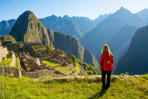 Woman looking at Machu Picchu at sunrise Canvas Print