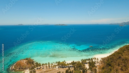 Spoed Foto op Canvas Tropical strand Aerial view of tropical beach on the island Malcapuya, Palawan, Philippines. Beautiful tropical island with sand beach, palm trees. Tropical landscape: beach with palm trees. Seascape: Ocean, sky, sea