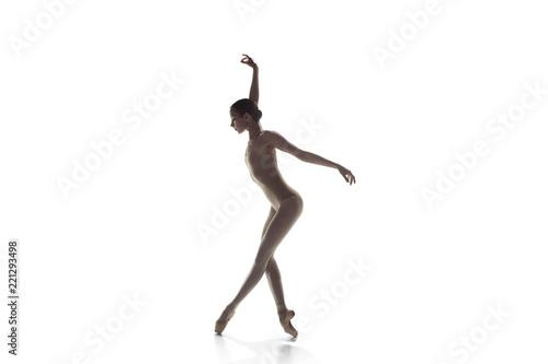 Young graceful female ballet dancer or classic ballerina dancing isolated on white studio Fototapeta