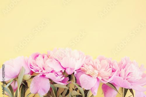 In de dag Bloemen Bouquet of pink peonies on a cream background, top view, copy space