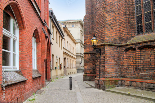 Photo Stands Narrow alley Berlin Spandau, old townt, narrow alley, Sankt Nikolai-Church