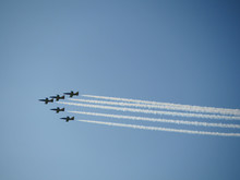 Reactive Jet Plane Flying In Formation And Leave Inversion Trail On Blue Sky
