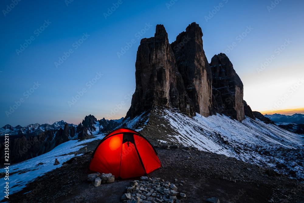 Fototapety, obrazy: Night bivouac at Tre Cime di Lavaredo, milion star hotel under night sky, red illuminated tent on pass in Dolomites, Italy.