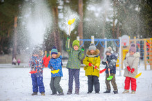 Cheerful Children Play In A Wi...