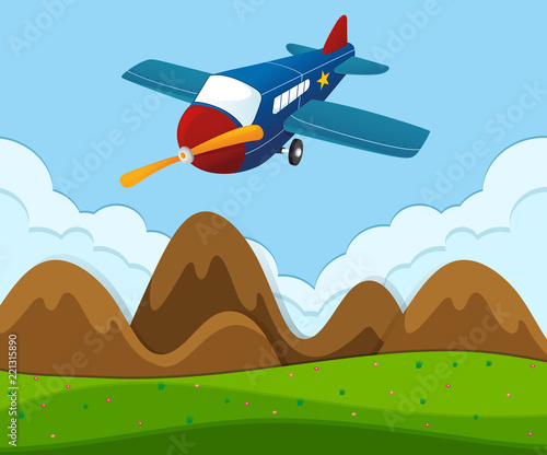 Airplane flying over the green landscape