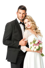 Beautiful Young Bride And Groom Embracing And Looking At Camera Isolated On White