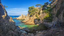 Wild Seascape Of Bay In Mediterranean Sea On Clear Sunny Day. Amazing View Of Rocky Shores Against Blue Sky And Coastline. Amazing Sea Nature Of Costa Brava, Spain. Landscape Of Bay In Lloret De Mar.
