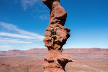 Rock Climber On Fisher Towers