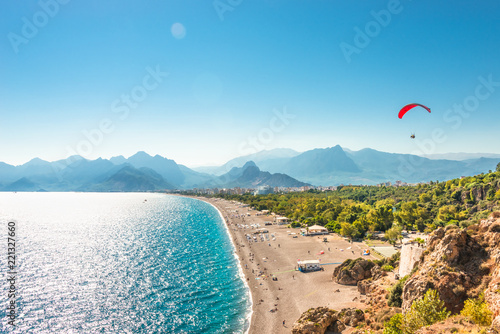 Panoramic bird view of Antalya and Mediterranean seacoast and beach with a paraglider, Antalya, Turkey