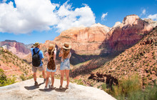 Family Hiking On Vacation, Relaxing On Top Of The Mountain, Looking At Beautiful  Mountains Scenery.  Zion National Park, Utah, USA