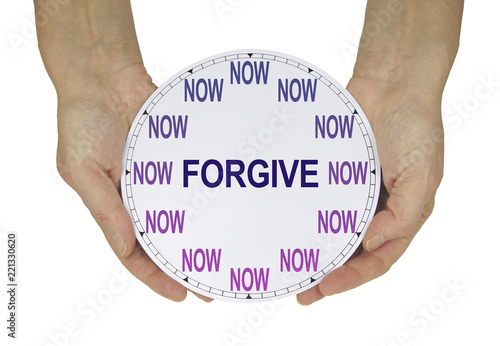 Slika na platnu NOW is the time to FORGIVE - female hands holding a clock showing NOW in place o