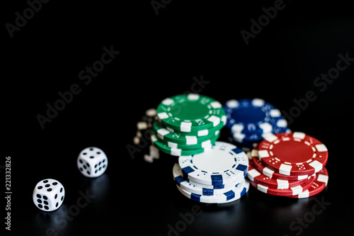 фотография  dice and colored casino chips on a black background