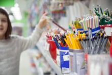 Girl Of 7 Years Old Choosing Stationery