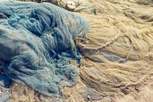 Fishing Nets Folded On The Sea...