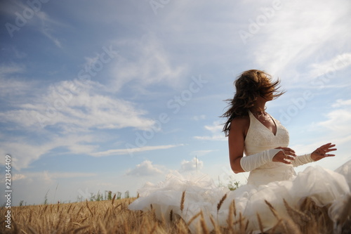 Fotografering  Mysterious bride lost somewere in a grain field