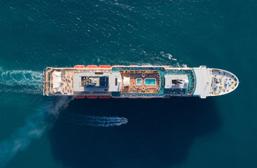 Tourist ship in the blue sea, aerial view