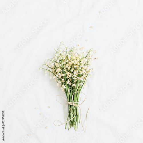 Foto op Canvas Lelietje van dalen Lily of the valley flowers on white background. Flatlay, top view minimal floral concept.